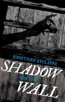 Shadow on the Wall, Paperback