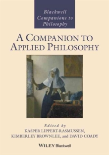 A Companion to Applied Philosophy, Hardback Book